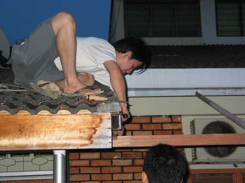 constructing roof over the koi pond