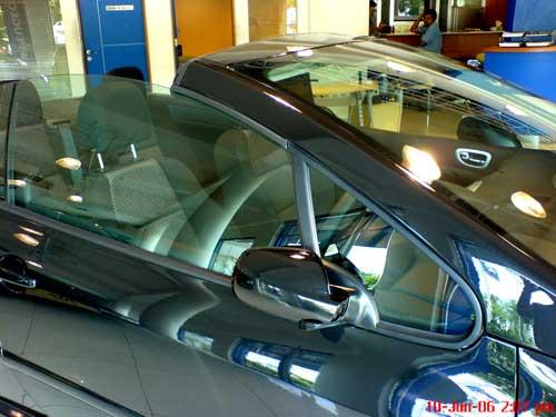 Black Peugeot 307CC driver side