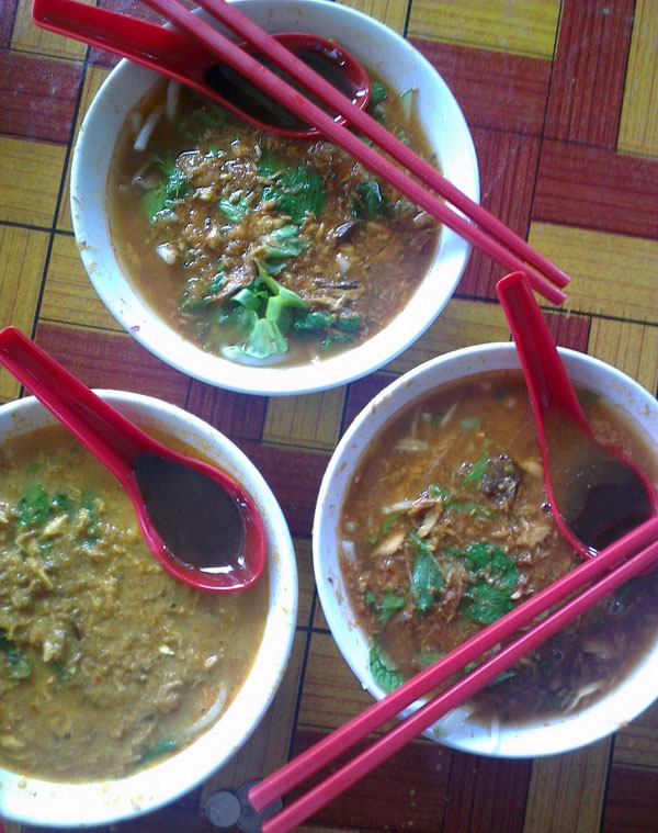 "two ""normal"" asam laksa, and one ""lemak"" version"
