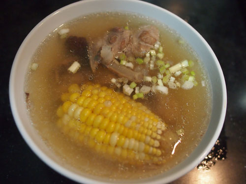 add a sprinkle of spring onion and you're done - corn &amp; spare ribs soup