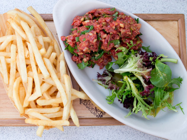 beef tenderloin tartare served with french fries