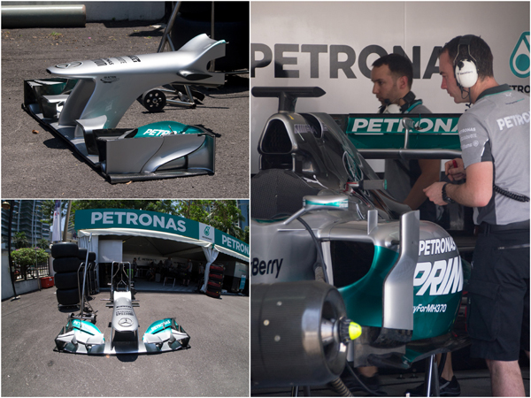 the 2013 Mercedes AMG PETRONAS F1 race car being prep