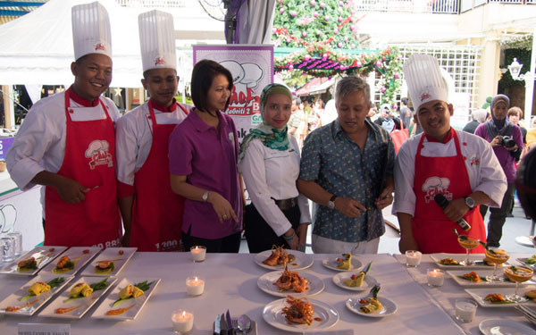 a photo with the contestants and judges, before tasting begins